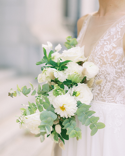 Bride with a white and green wedding bouquet