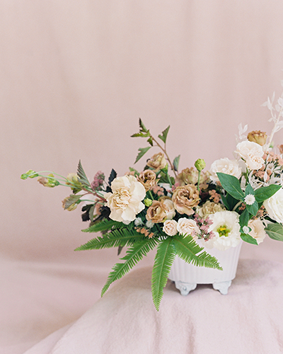 Blush and terra cotta wedding flower arrangement