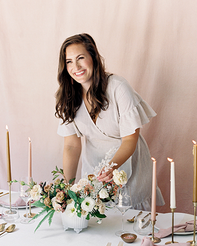 Alexia Crossman, owner of Wiley Events Co, setting table