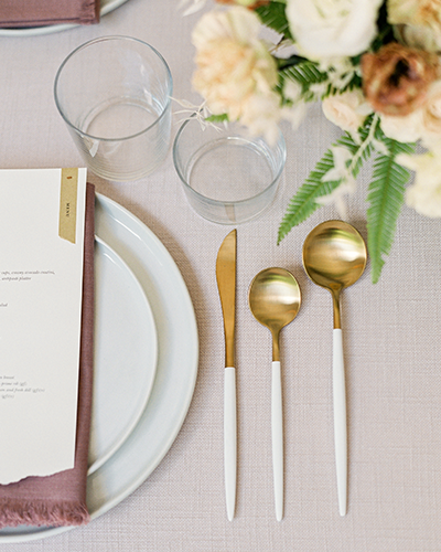 Modern table setting with flowers and menu card