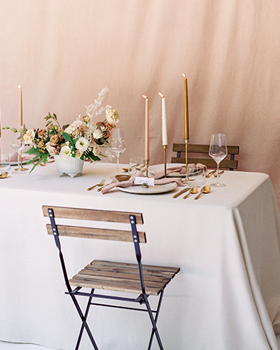 Blush wedding table with dried florals and tapered candles