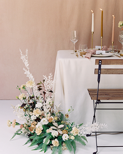 Blush wedding table with dried floral arrangement