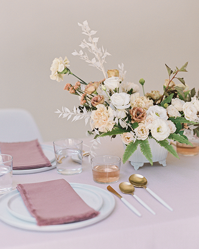 Pink wedding table with blush flower arrangement