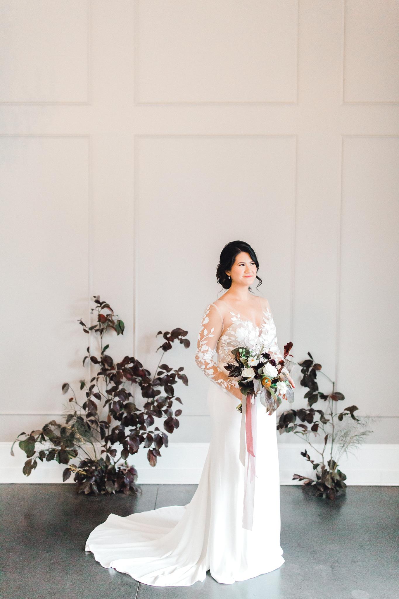 Bride in long sleeved wedding gown