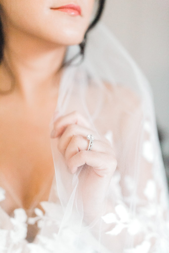 Close up of bride and engagement ring