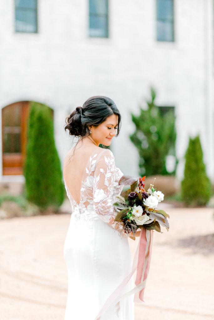 Bride in long-sleeved wedding gown