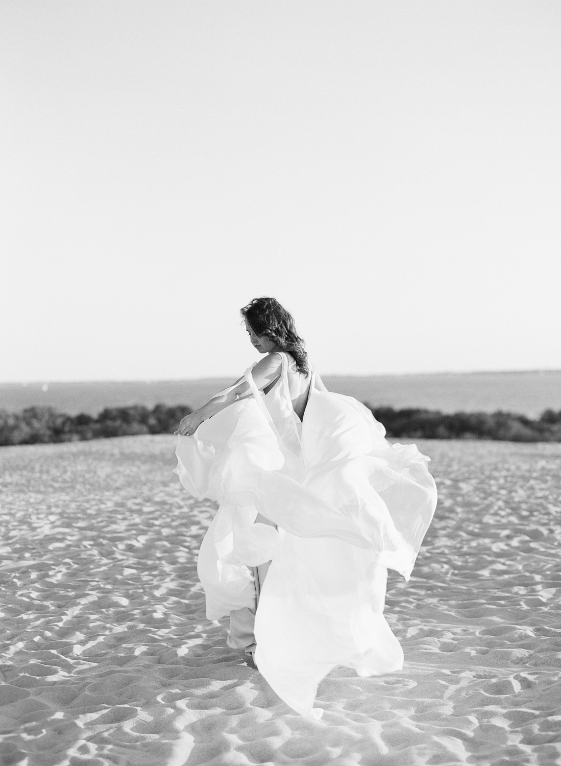 Beach wedding - bride with flowy gown on the beach