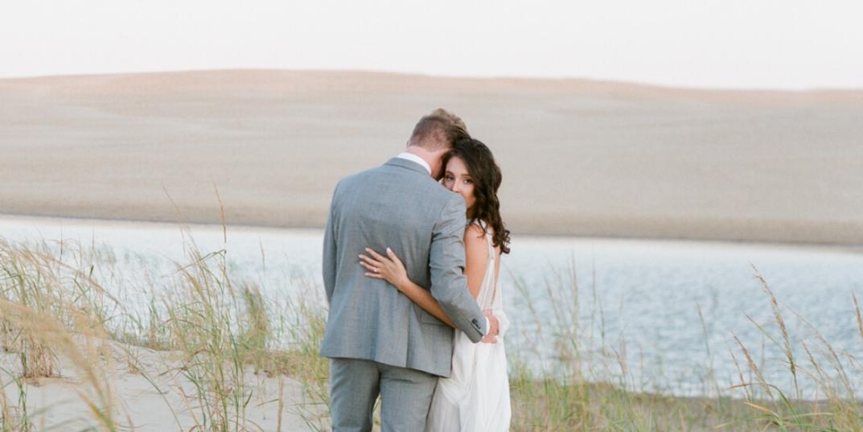 Couple on a beach on their wedding day