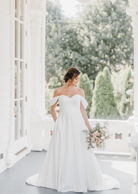 Bride in wedding gown at Merrimon-Wynne House wedding