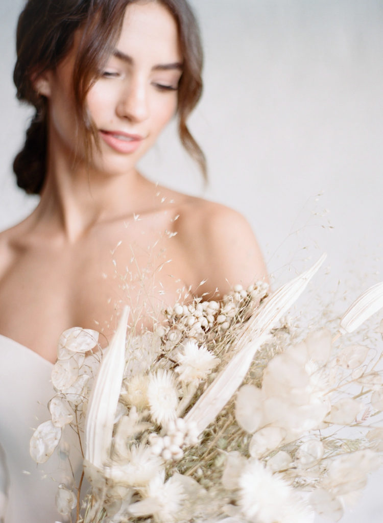 Bride with dried floral bouquet