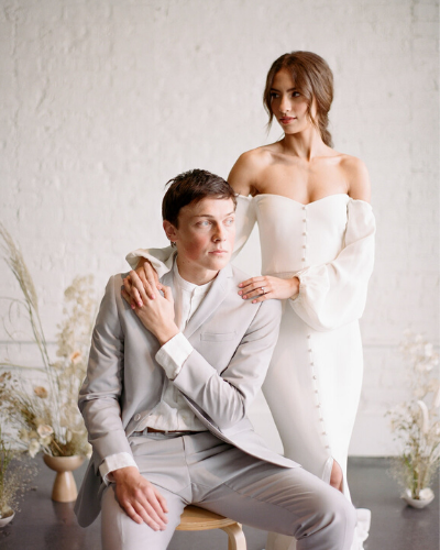 Bride and groom pose at minimal gathering