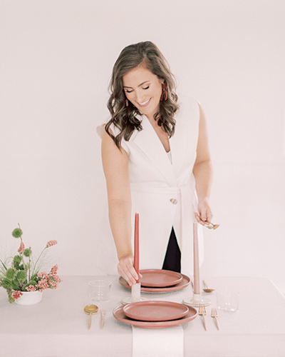 Wedding planner setting a table