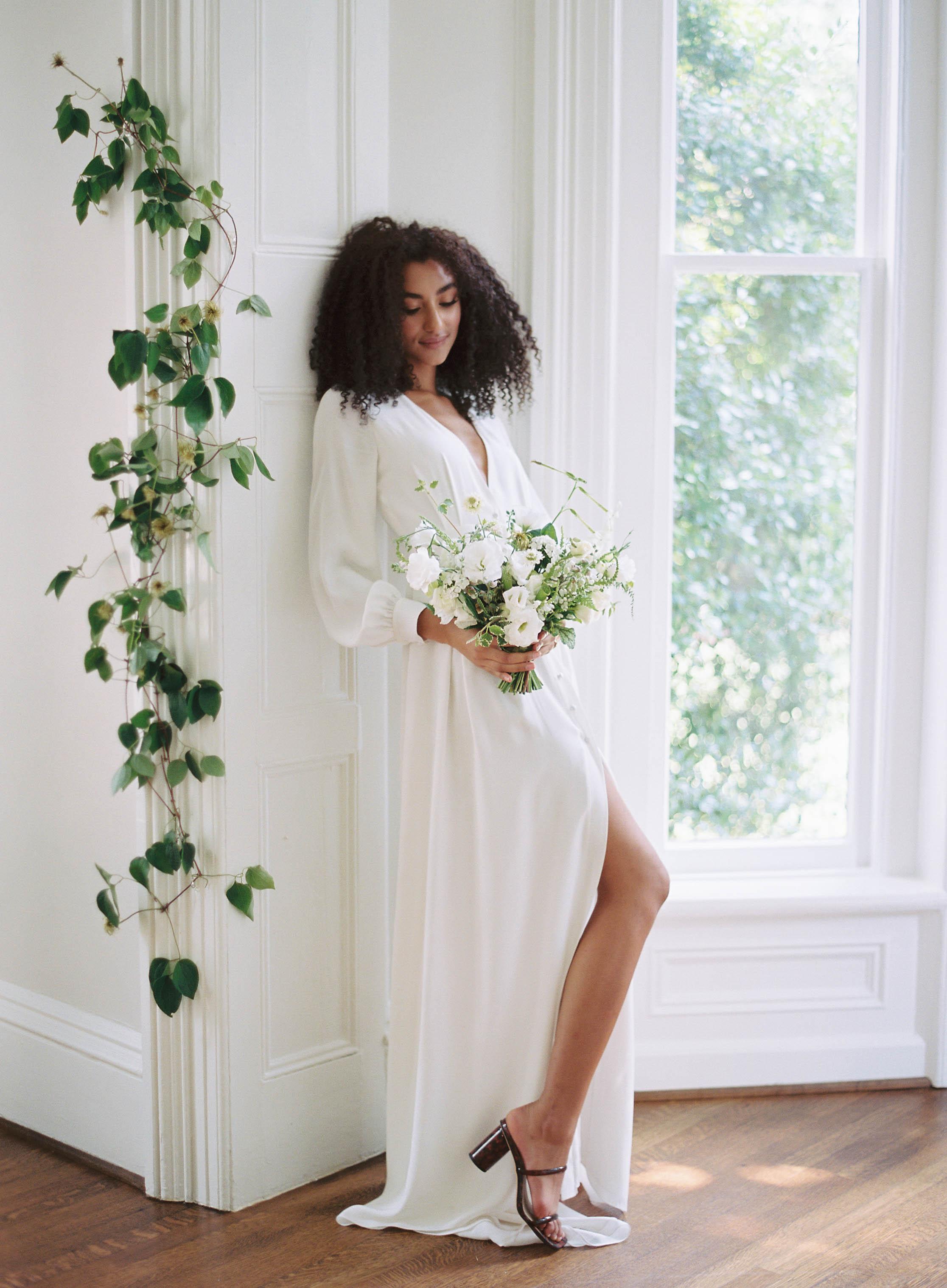 Bride in elegant white long-sleeved gown