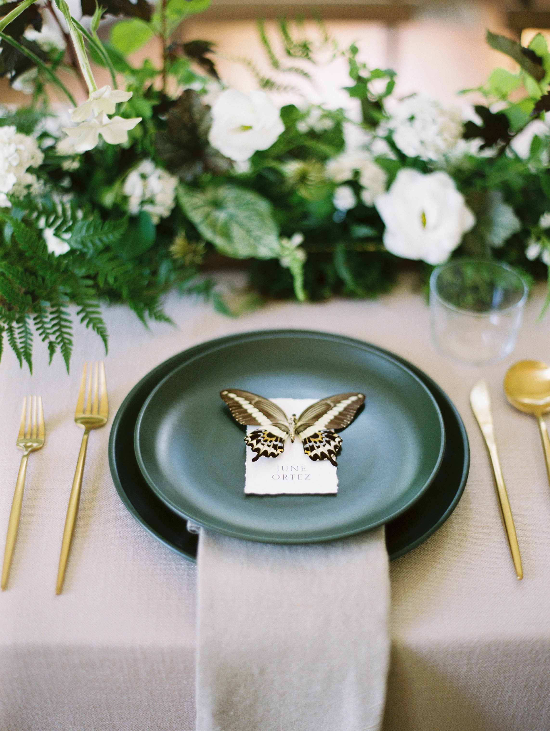 Botanical tablescape with butterfly escort card